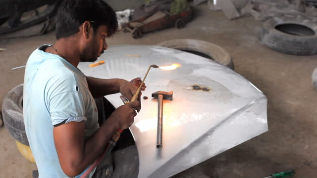 indian mechanic manual worker repairing car bonnet - mechanic stock videos and b-roll footage