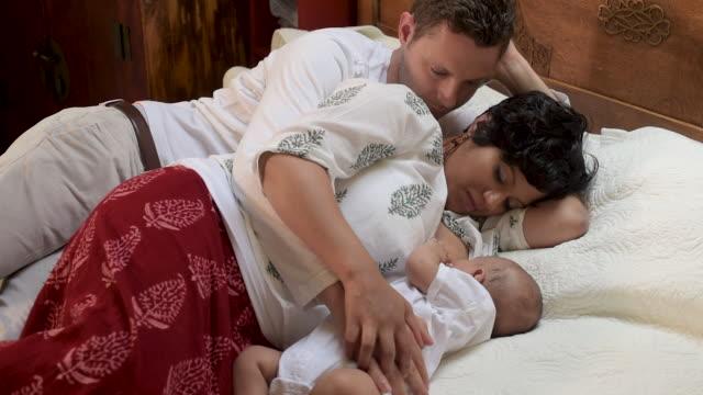 indian mother breastfeeding newborn. - breastfeeding husband stock videos & royalty-free footage