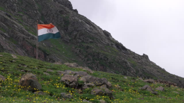 indian national flag at a military base in kashmir himalayas close to the international border or the 'line of control' between india and pakistan - pakistan video stock e b–roll