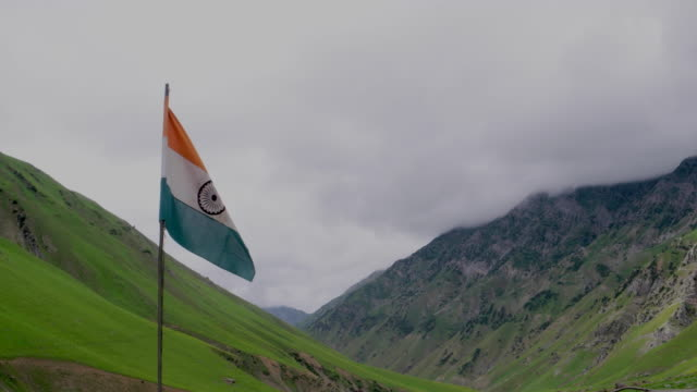 indian national flag, the 'tricolour', fluttering high somewhere in the gadsar valley in kashmir himalayas - indian flag stock videos & royalty-free footage