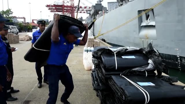 indian navy troops offload emergency supplies from the indian ship kirch at colombo harbour part of a relief operation to assist victims of floods in... - south asia stock videos and b-roll footage