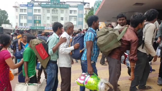 indian non kashmiri migrant workers who were working in the troubled region reach the railway station in jammu to leave for their homes after after... - refugee stock videos & royalty-free footage