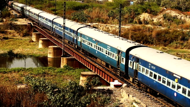 indian passenger train crossing bridge - india video stock e b–roll
