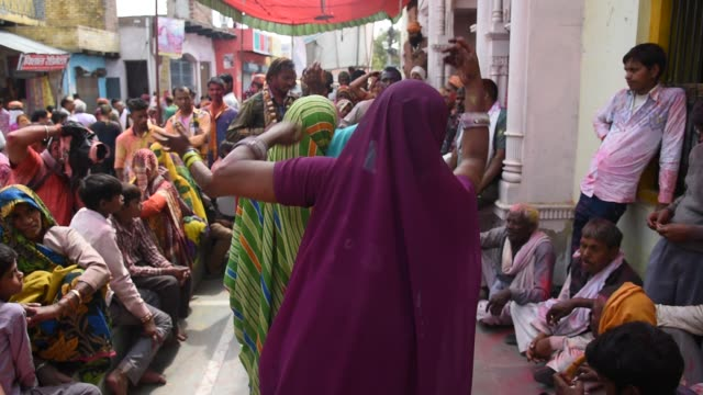 stockvideo's en b-roll-footage met indian people dancing and during the holi celebration, nandgaon, india. - overige