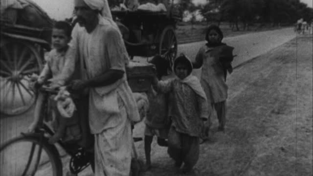 indian people traveling on road from pakistan during partition of india / india - 1947 stock videos & royalty-free footage