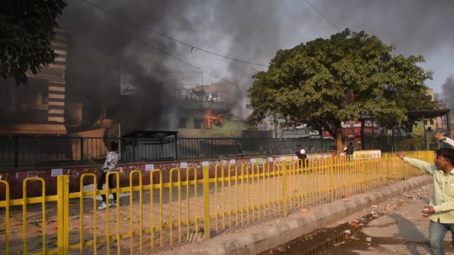 indian police and the protesters supporting a new citizenship law chase away those opposing a new citizenship law in front vandalized property of... - delhi stock videos & royalty-free footage