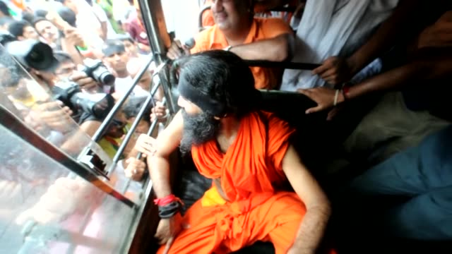 Indian police arrest famed TV yoga guru and anticorruption campaigner Baba Ramdev as he attempts to lead a procession of thousands of supporters to...