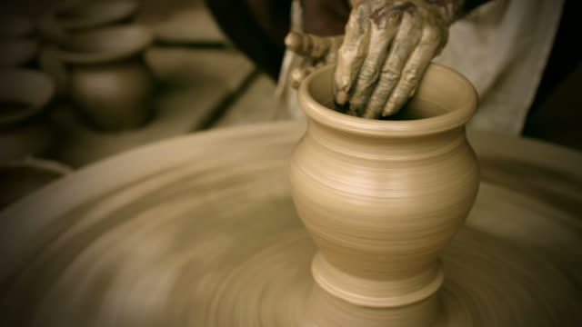indian potter's skilled hand shaping pot on manual pottery wheel - potter's wheel stock videos & royalty-free footage