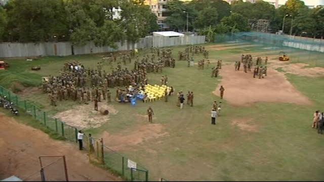 indian premier league may move to united kingdom tx indian troops lining up for parade on former cricket pitch - クリケット点の映像素材/bロール