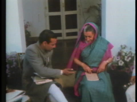 indian prime minister indira gandhi takes a seat for an interview. - (war or terrorism or election or government or illness or news event or speech or politics or politician or conflict or military or extreme weather or business or economy) and not usa stock videos & royalty-free footage