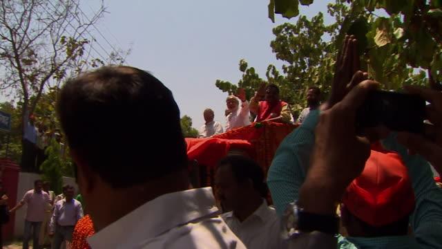 Indian Prime Minister Narendra Modi greeting crowds in Assam