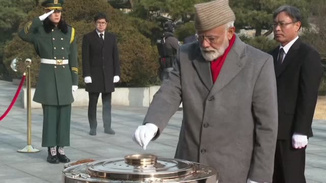 Indian Prime Minister Narendra Modi makes an offering at the War Memorial of Korea during a visit to the South Korean capital