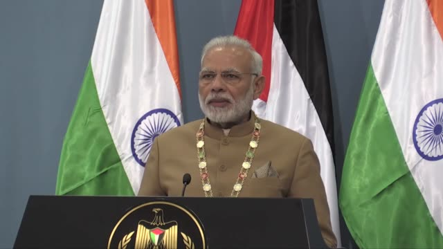 Indian Prime Minister Narendra Modi speaks at a joint press conference with Palestinian President Mahmoud Abbas in the West Bank city of Ramallah on...