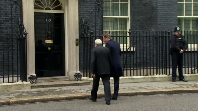 Indian Prime Minister Narendra Modi visit ENGLAND London Downing Street Modi and Cameron across to Number 10 and shaking hands in from of door for...