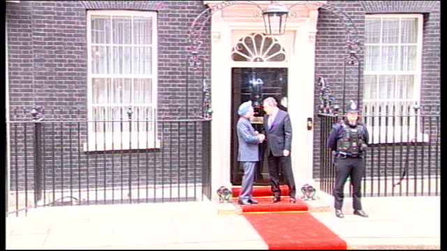 Indian Prime Minister visits Downing Street ENGLAND London Downing Street EXT Gordon Brown MP and Manmohan Singh out of Number 10 then shaking hands...