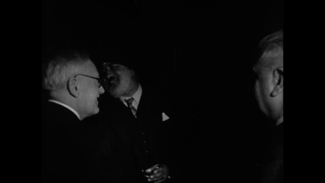 Indian representative to UN Rajeshwar Dayal organizer of reception greeting guest entering room where reception is being held / VS Vyshinsky mingles...
