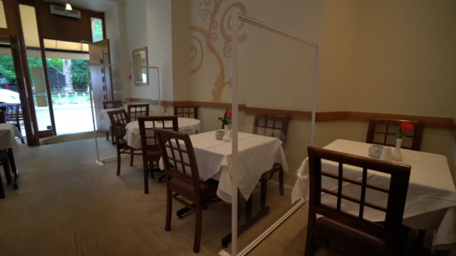 indian restaurant paradise in hampstead sets up paritions for dinners as they open to dine in customers in the evening on july 4, 2020 in london,... - cafe stock videos & royalty-free footage