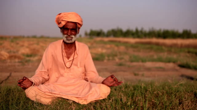 indian sadhu doing yoga outdoor in the nature - monk stock videos & royalty-free footage