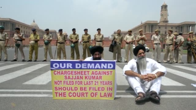 indian sikhs protest against the acquittal of a congress politician linked to the massacre of their community following the 1984 assassination of... - acquittal stock videos and b-roll footage