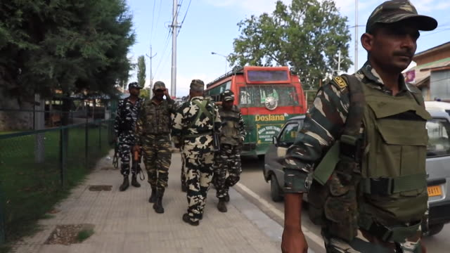 indian soldiers and police on streets of srinagar as kashmir's special status is removed by the government and the town goes into lockdown - india stock videos & royalty-free footage