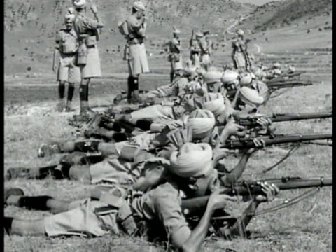 indian soldiers marching on road ls soldiers laying on ground firing rifles vs soldiers loading small cannons aiming firing from hill vs british... - british empire stock videos & royalty-free footage