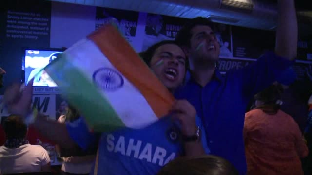 indian supporters celebrated their countrys comfortable six wicket victory over arch rivals pakistan in the world twenty20 saturday - wicket stock videos and b-roll footage
