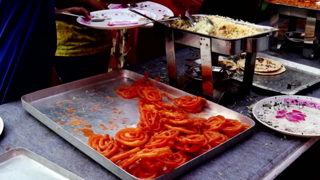 indian sweet food jalebi is being served - sweet food stock videos & royalty-free footage