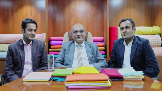 indian textile industrialist with son in the boardroom - chairperson stock videos & royalty-free footage
