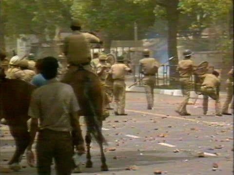 Indian troops clash with Sikh's in New Delhi following the Indian governements storming of the Sikh Golden Temple in Amritsar