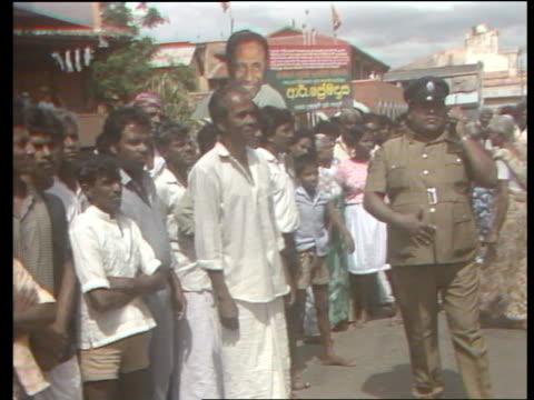 Indian troops withdraw ITN LIB People standing in street Soldiers in jeep People on street