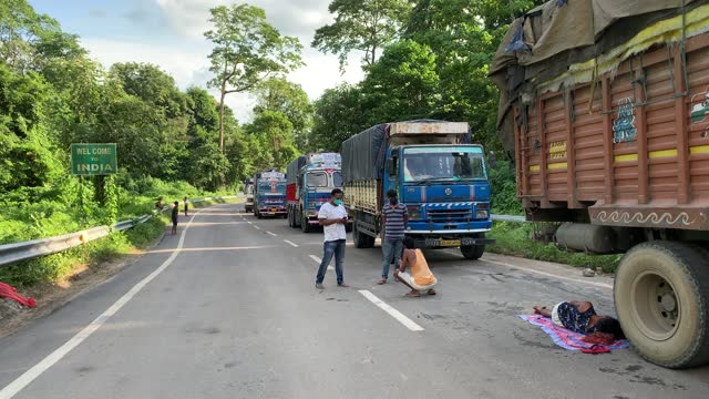 IND: People And Vehicles Wait On Indo-Bhutan Border In India