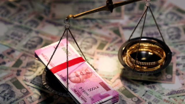 indian two thousand banknotes and jewellery on a weighing scale - balance stock videos & royalty-free footage