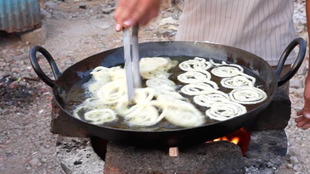 Indian Vendor making Jalebi Funnel Cake at Road side stall