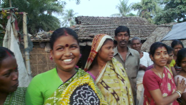 Indian villagers smiling for the camera.