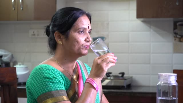 indian woman drinking water. - drinking water stock videos & royalty-free footage