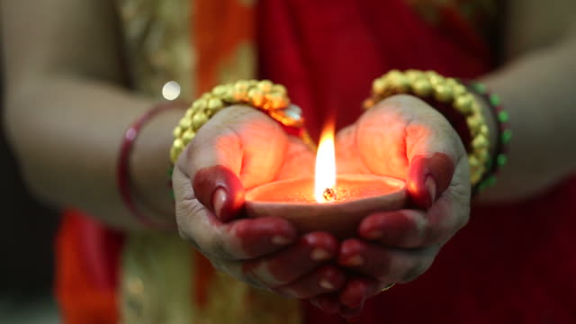indian woman holding diwali oil lamp - oil lamp stock videos & royalty-free footage