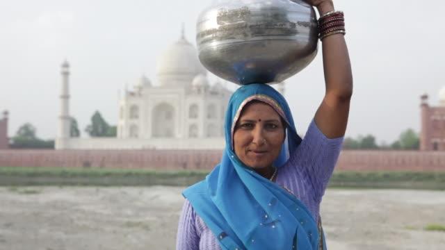 MS Indian Woman in traditional Sari in front of Taj Mahal / Agra, Uttar Pradesh, India