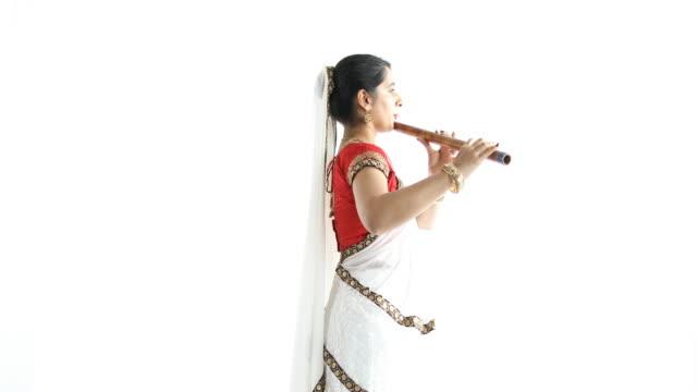 indian woman playing bansuri - wind instrument stock videos & royalty-free footage