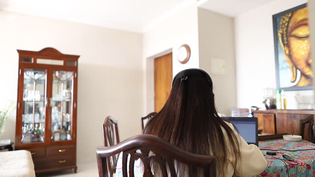 indian woman sitting in her living room working remotely amid covid-19 pandemic. india has decided to lift decades-old restrictions on remote work in... - teleworking stock videos & royalty-free footage