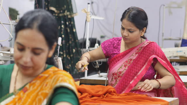 indian woman textile worker cutting dress fabric on production line - textile stock videos & royalty-free footage