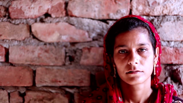indian women portrait on brick wall - poverty stock videos & royalty-free footage