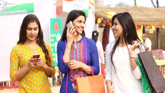 indian women shopping at street market - indian culture stock videos & royalty-free footage