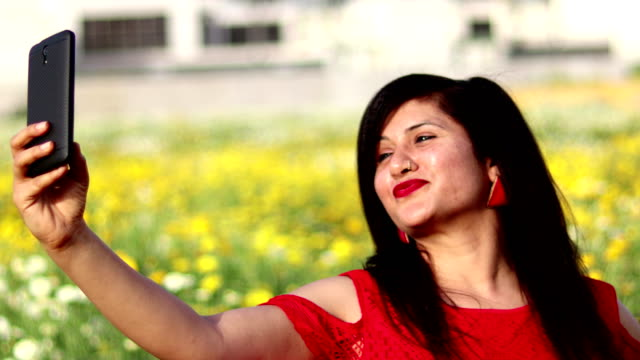 indian women taking a selfie by using smart phone - south asia stock videos & royalty-free footage