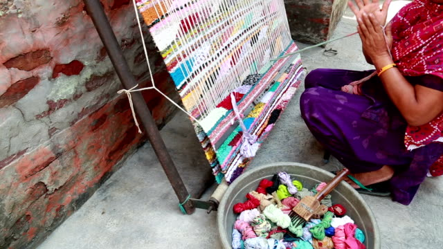 indian women weaving textile (durry) . - textile stock videos and b-roll footage