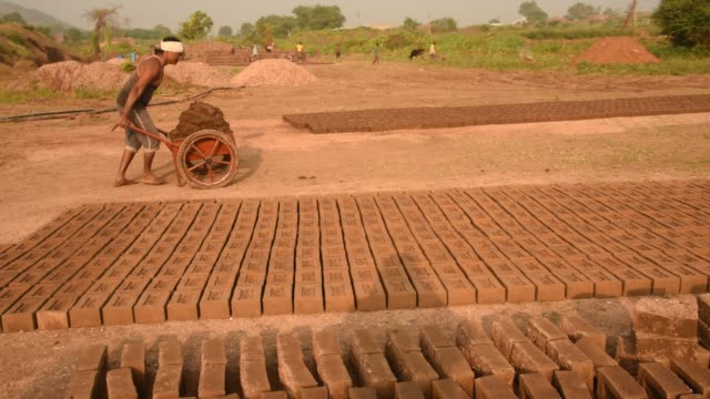indian workers making wet clay bricks, aurangabad, india. - mud stock videos & royalty-free footage
