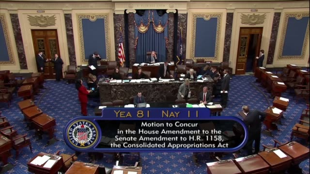 indiana senator mike braun announces the senate vote to concur in changes to legislation on final passage funding the department of defense... - department of justice stock videos & royalty-free footage