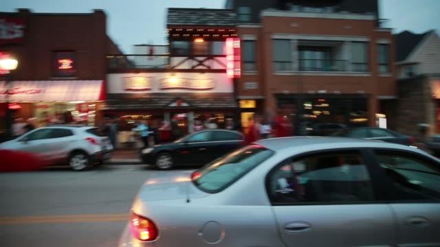 Indiana University fan run down Kirkwood Avenue cheering after the Indiana University Hoosiers beat University Kentucky during the NCAA basketball...
