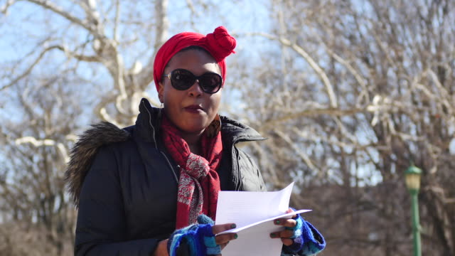 vídeos de stock, filmes e b-roll de indiana university graduate student andrea sterling speaks during a demonstration in response to donald trump's executive orders at the showalter... - bloomington indiana