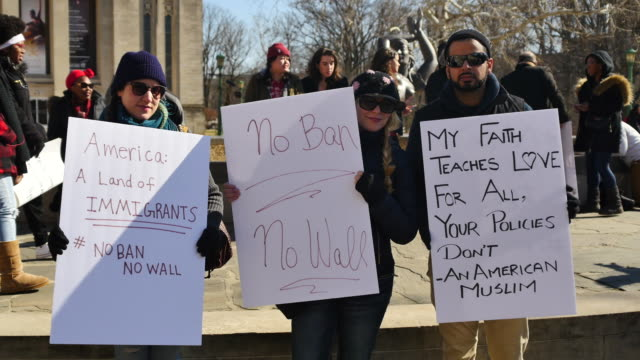 vídeos de stock, filmes e b-roll de indiana university students gather for the #iutakesastand a peaceful demonstration in response to donald trump's executive orders at the showalter... - bloomington indiana
