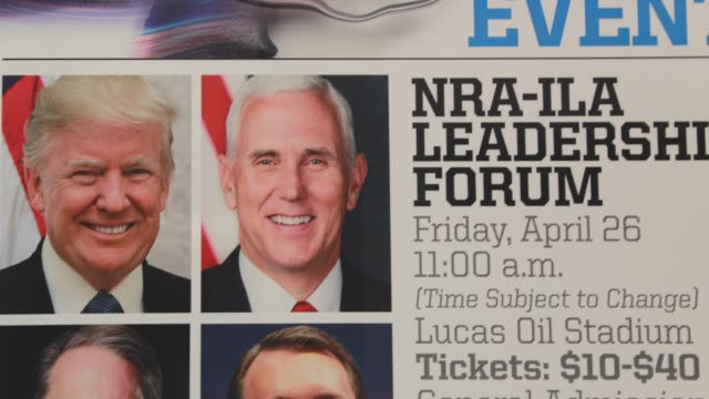 indianapolis, indiana, usa: a banner lists events and features photos of united states president donald j. trump, and vice president pence, along... - 全米ライフル協会点の映像素材/bロール